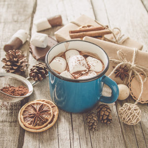 62397296 - hot chocolate with marshmallows in white cup, toned