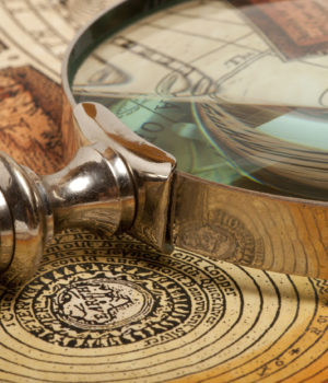 46783114 - magnifying glass and ancient old map
