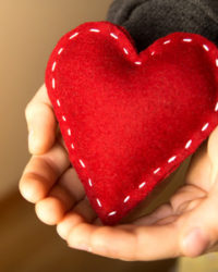 33237834 - red heart in child hands, gift, hand made valentine, close up, horizontal